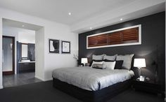 Cool bedroom...I like the black/white/grey color scheme. Very manly.
