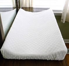 Free Baby Projects: Contoured Changing Pad Cover.  This blog also has several other projects.