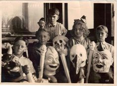 Children & masks, 1920s.  Reminds me of Miss Pettigrew's Home for Peculiar Children, which, if you haven't read it, you should!
