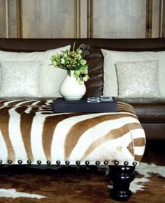Brown zebra ottoman Hereford cowhide rug unexpected pairing with blingy pillows on sofa. Decor, Ottoman, Furniture, Home Accessories, Leather Furniture, Home Decor, Home Decor Color, Colorful Decor, Furnishings