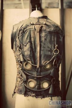 some chains and taupalin reinforcement rings lifts this peice from being just an old vest