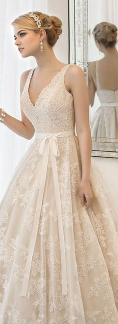 vintage lace wedding dresses with ribbon. A simple wedding dress that still looks beautiful with and up due and a natural makeup look. I think that Hermia would repin this because she is all about a figure flattering dress and loves lace, this dress would look amazing on her.