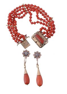 A pair of coral earrings, the facetted coral drops suspended from quatrefoil...