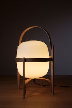my ultimave gift from when I got married - the CESTA lamp by miguel milá from the 1960's - by santa
