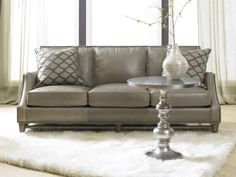 The Madigan Stationary Sofa 8-Way Tie is offered in hundreds of leather options and includes a standard nailhead trim #9 in natural finish.