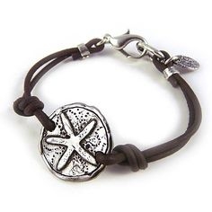 """Dive Into Your Dreams - Leather and Sterling Silver Plate Starfish Bracelet, 7.25"""" Island Cowgirl. $67.99. Sterling silver plated 1"""" medallion emblazoned with rustic starfish design. Durable, knotted chocolate-brown leather cording. Measures 7-1/4"""" with a double-plated sterling silver lobster-claw clasp. Plated in sterling silver, with 5x the amount of normal plating to prevent wear and provide a higher quality standard. Made in the USA"""