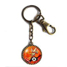 Pokemon Blaziken Pokeball Keychain Key Chain Key Ring Cute Keyring Car Anime Blazikenite Mega Stone Cosplay. Size:L8X3CM Pendant Size: 2.9CM Colors: Ancient bronze Material:Alloy+Glass.