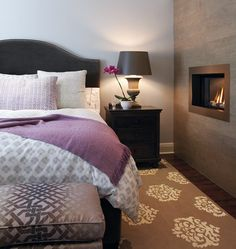 Purple Rooms | House & Home - A fireplace takes bedroom glamour and comfort to a new level.      The subtle layering of pattern and texture keeps this principal bedroom's lavender accents from feeling too feminine.
