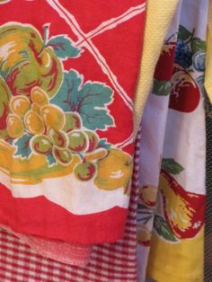Vintage kitchen linens:  Bright cheery prints like these were common in kitchens everywhere in the '40's and '50's....dish towels, table cloths, curtains......  They are collectible today.