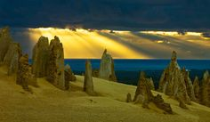 Pinnacle Light Shafts by Frank Richardson, The Pinnacles (late afternoon) Nambung, Western Australia