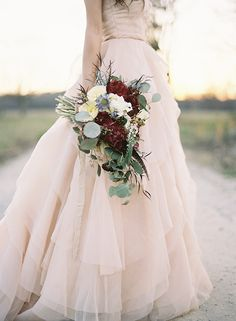 Gorgeous blush gown and rustic #burgundy #white #cream bouquet | photo by Eric Kelley