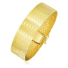 """Positively stunning in fine 14K yellow tone gold, this omega chain bracelet showcases a thick brick-like motif. Available in size 7"""" and secured with a box clas"""