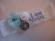 """Shabby chic stretch lace wedding garter embellished with satin rosettes and organza flowers.  """"I am Yours"""" embroidery personalization.  Garter Style 0 from TheWeddingGarter.com"""