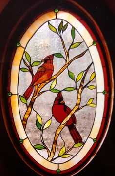 This powder room window is right by the front door.  The clients love cardinals, love the natural setting of their home. This window helps capture that.