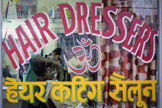 A man gets a shave inside a barber shop at a slum in Mumbai September 17, 2014. (REUTERS/Danish Siddiqui)