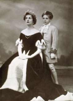 Deborah, Duchess of Devonshire and her son,The Marquess of Hartington. Cecil Beaton called Deborah 'the most beautiful of all' the peeresses in this off-the-shoulder robe, believed to have been reworked from an original worn by Georgiana, wife of the 5th Duke of Devonshire.