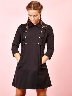 For a chic bookish charm, opt for this black mini dress with pearl embellishment and ruffle detail on bib. 3/4 sleeves     Fabric Composition: Main : 100...