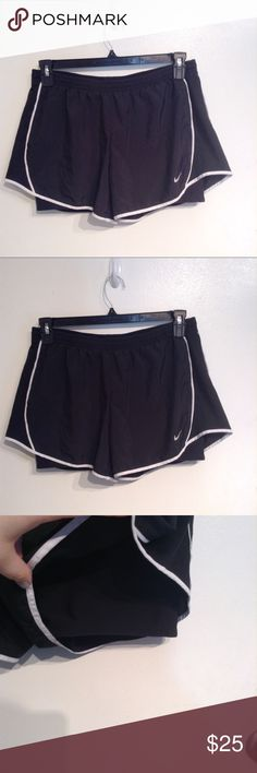 """NIKE Dri-Fit Black Layered Workout Shorts Nike Dri-fit classic black with white trim workout shorts. Fitted compression under layer with Flowy layer over top. Perfect for athletic wear or athleisure. Elastic and drawstring waist. Size large. Measures 16"""" flat and unstretched at waist, just over 10"""" front rise, and 3.5"""" inseam. No modeling. Smoke free home. I do discount bundles. Nike Shorts"""