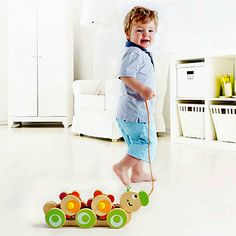 This colorful wooden pull-toy stimulates early walking with smiling sunflowers that turn with every step your toddler takes. Walk-A-Long Caterpillar from Hape.  Ages 1 to 3 years.