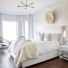White and cream bedroom furnished with a white channel tufted bed dressed with white bedding and pillows and accented with a cream faux fur throw. Cream And White Bedroom, Cream Bedrooms, White Wall Bedroom, Home Bedroom, Bedroom Decor, White Walls, Master Bedroom, White Ikea Bed, White Tufted Bed