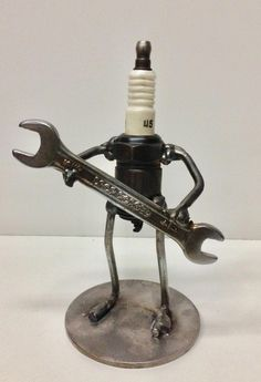 """Junk art sculpture made from some scrap steel, a spark plug and an old wrench. Made by Brookwood Garage. Search """"Brookwood Garage"""" on Etsy to purchase. Metal Sculpture Artists, Steel Sculpture, Sculpture Ideas, Art Sculptures, Welding Art Projects, Metal Art Projects, Metal Tree Wall Art, Scrap Metal Art, Recycled Metal Art"""