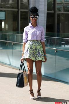 Blogger Simone Peart pairs a major miniskirt with a classic striped button-down, for a super easy way to try the shirting trend. Bonus: She's wearing an Asos skirt, a Forever 21 top, and Guess heels.