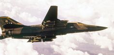 An F-111 Aardvark of the US Air Force flies over Vietnam with a full load of sixteen 800-pound cluster bombs. (USAF Photo)