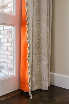 great idea...pop of color on the back of a neutral drape panel