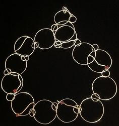 Sterling silver loop necklace with cab garnets, pink tourmaline, lab ruby and amethyst. Organic styling with a touch of medieval. Deborah Haste/wearaboutart.com