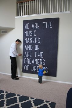chalkboard paint on a giant canvas... this way we don't teach the kids its ok to draw on walls...