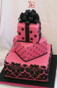 hot pink and black square tiered cake