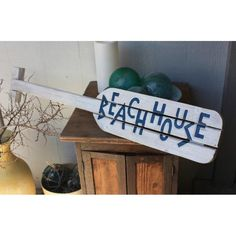 "Great looking hand carved weathered looking nautical oar with coastal white and blue ""Beach House"", ready to hang! This piece measures 40 inches long by 9 inches wide. Great coastal decor for any beach themed home. Perfect for the outdoor living area! Beach Color, Blue Beach, Tropical Decor, Coastal Decor, Coastal Living, Nautical Bedroom Furniture, Nautical Artwork, Beach House Signs, Beach Houses"