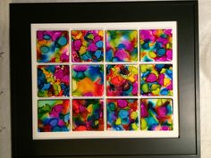 Alcohol inks on tiles, framed for our auction.