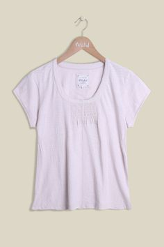 Our Day Dreamer Tee is 100% cotton making it super-soft and lightweight, perfect for the upcoming seasons. The far from basic tee offers stirring detail on the chest and an elegant lace hem along the rounded neckline. Perfectly paired with one of our cardigans and jeans. Also available in Grey and Blue Glow.