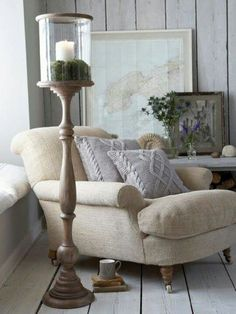 I want to cuddle up with a cup of tea, blanket and book!  Love this chair and the other rustic elements surrounding it. LOVE!