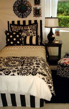 Thinking of adding black and white theme to guest room; remember to use a bedskirt to pick up the theme.