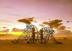 Ukrainian sculptor, blacksmith, & designer Alexander Milov's sculpture titled 'Love' features two adults sitting back to back while the inner sculpture displays the two children touching hands through the metal wires. It demonstrates a conflict between a man and a woman as well as as the outer & inner expression of human nature.