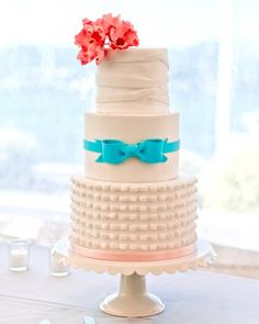 The cake's exterior was modeled after the wedding dress, but inside it was all about flavor: chai batter with hazelnut filling, and chocolate with Baileys liqueur. Yum!! Cute idea
