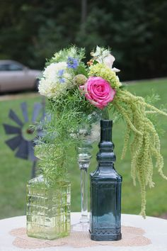 bottles and flowers for the highboys around the pool