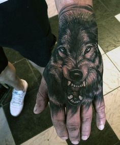 wolf hand tattoo ideas for men