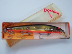 Bomber Long A Fishing Lure Vintage Screwtail 16A 7/8 ounce 6in Black gold orange #Bomber
