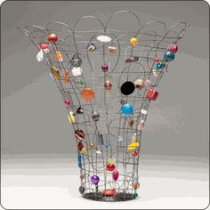 "Wire Basket with Found ItemsDescription    Handmade by artist Sally Prangley.  13"" H x 8"" D"