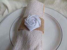These rustic napkin rings are the perfect finishing touch to your rustic wedding decor. These handmade rosettes are made from the cotton fabric