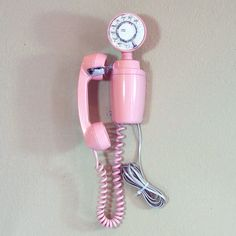 "Rare 1965 Pink Space Saver Phone by Little Pleasures - Rare 1965 Pink Space Saver Phone, which is fondly known as the ""Jetson"" phone among collectors. Rarely produced in this pink hue, this phone was designed to be compact to fit into modern spaces. Its breathtaking design is sure to be the talk of your area code."