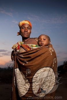 a mother carrying her child in a traditional way, manica, mozambique, africa