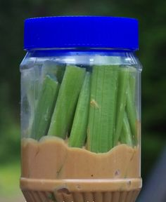 Such a smart travel snack idea: reuse a PB jar and add celery sticks or veggies + dip
