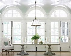 Hall inside a home with arched windows, curved ceiling and ceilings painted in a high gloss glossy light blue - lacquer ceilings!  http://cococozy.com