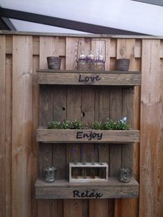 Pallet turned into garden decoration.