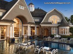 Dine outdoors in peace and in style on the delightful private paver patio with a fireplace, or lounge in the luscious pool and hot tub area overlooking the water.
