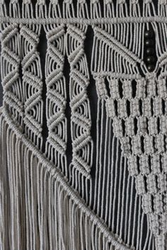 Macrame wall hanging made from cotton yarn. Bamboo dowel. Made to order - I need 2 weeks for producing.  Dowel is 25 inches (64cm) long. From the dowel to the bottom of the fringe: 45 inches (114cm).  Care: dry clean only.  Actual colours may a little vary from those shown on your screen due to differences in display graphics from one monitor to another.  More interior decor items you can find here: https://www.etsy.com/shop/KadabrosFelt?ref=hdr_shop_menu§ion_id=7581781